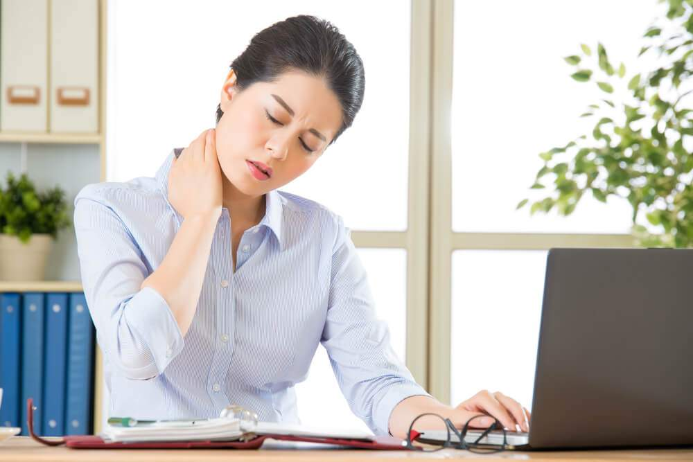 Office woman in need of a cure for fibromyalgia pain