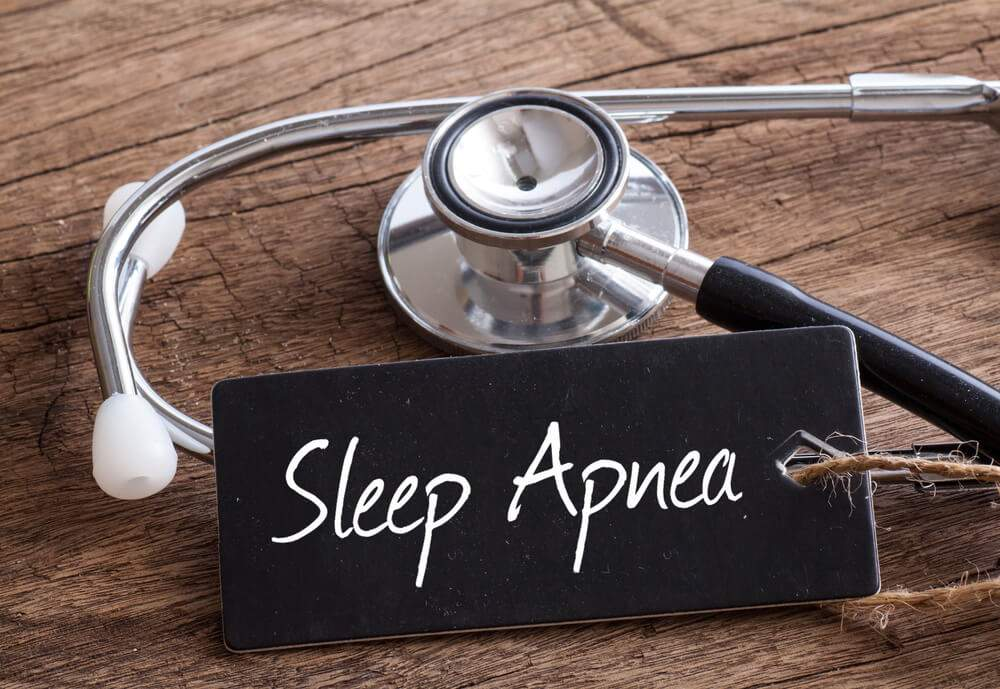 A stethoscope and a sign showing sleep apnea