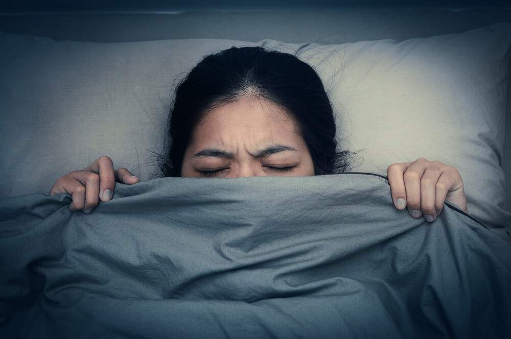 A woman is unable to fall asleep due to night terrors