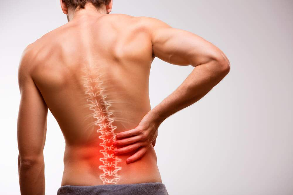 A man is suffering from low back pain