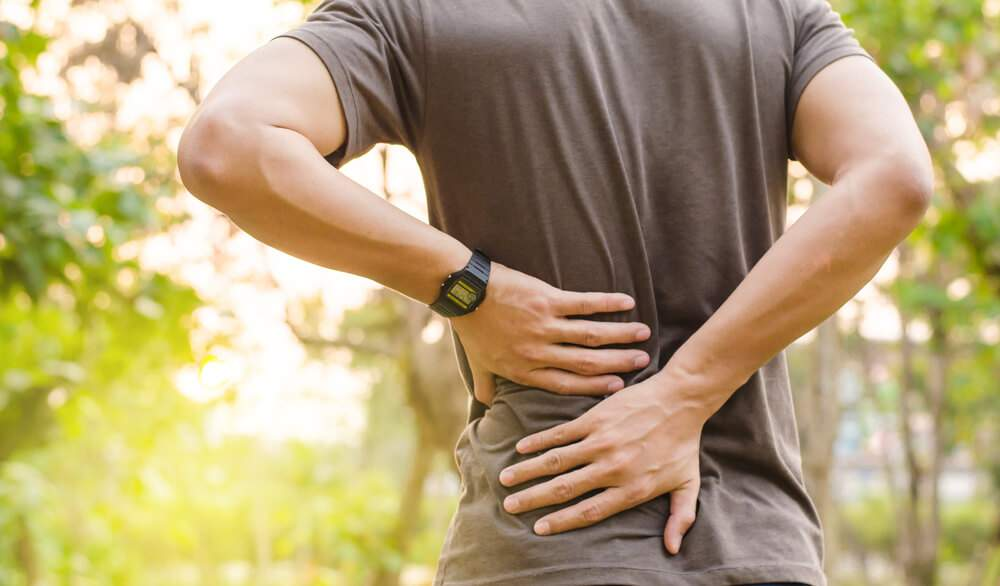 A man is suffering from lower back pain