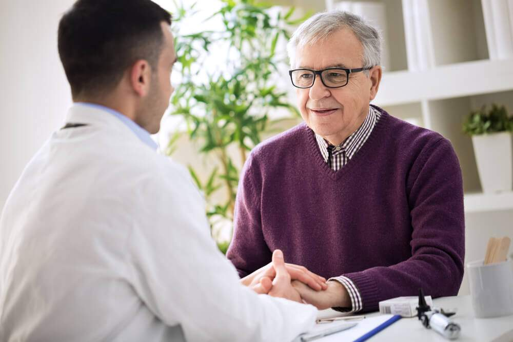 An older man has an appointment with a doctor